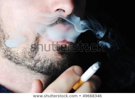 Homme fumer sombre visible fumée visage Photo stock © zurijeta