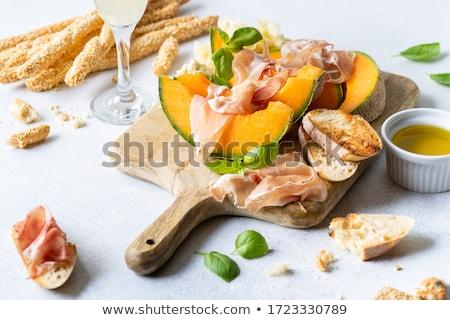 vers · meloen · prosciutto · basilicum · antipasti · houten · tafel - stockfoto © m-studio