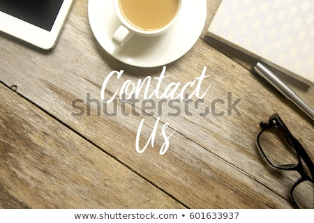 Contact us sign on wooden table Stock photo © fuzzbones0