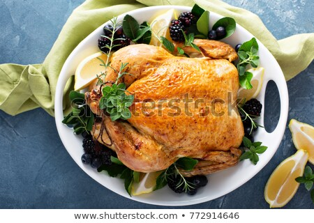 Roasted garlic and lemon turkey with vegetables and rosemary. Homemade dinner Stock photo © frimufilms
