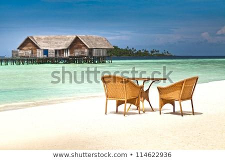 Сток-фото: Round Table And Wicker Chairs