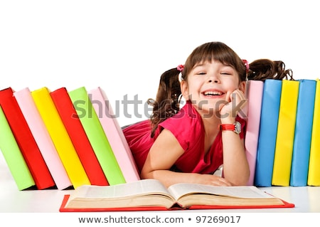 Beautiful little girl sitting and holding red book Stock photo © deandrobot