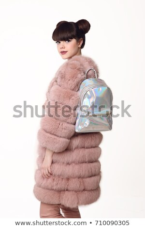 brunette smiling teen girl in pink fur coat advertise backpack stock photo © victoria_andreas
