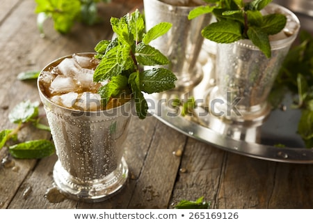 mint julep cocktail with bourbon ice and mint in glass stock photo © fotoart-md