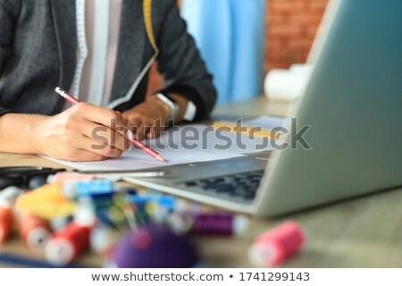 Crop shot of dressmaker drawing sketches Stock photo © dash