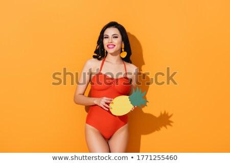 улыбаясь девушки купальник ананаса глядя Сток-фото © deandrobot