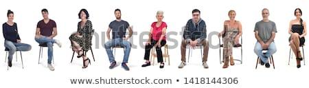 Jovem elegante homem sessão cadeira Foto stock © filipw