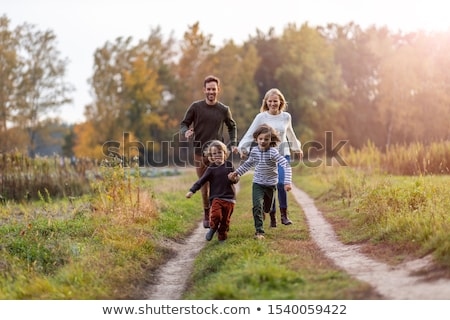 happy kid boy in park walking outdoor stock photo © dariazu