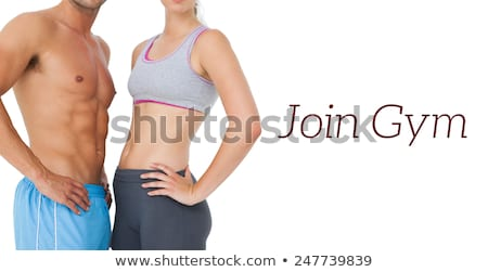 Fit couple with hands on hips Stock photo © wavebreak_media