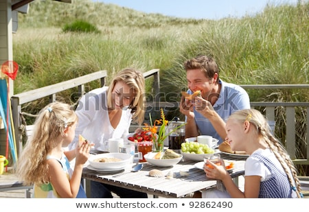man sitting on table in chalet Stock photo © IS2