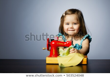 Girl learning to sew Stock photo © IS2