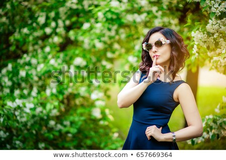 smiling women sitting by tree in orchard stock photo © is2