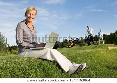 Homem golfe verde bluetooth fone comunicação Foto stock © IS2