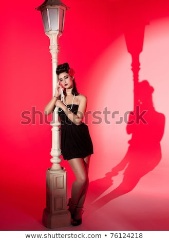 Young Woman And Lightpole Foto stock © clearviewstock
