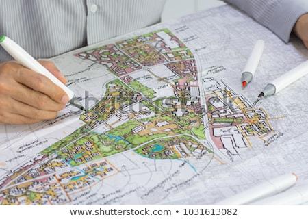 City plan with worker. Stock photo © ra2studio