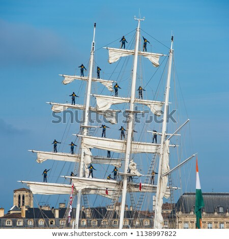 Sailors standing on the masts of an old gable on arrival in the port of Bordeaux stock photo © FreeProd