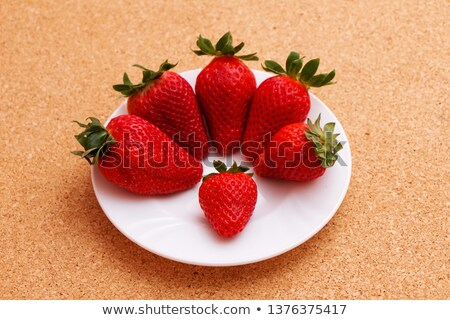 fresh raw organic berries isolated in white ceramic bowl plate on kitchen table background top view stock photo © denismart