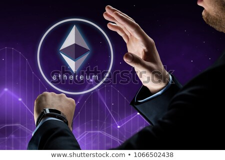 hands with smart watch and ethereum hologram Stock photo © dolgachov