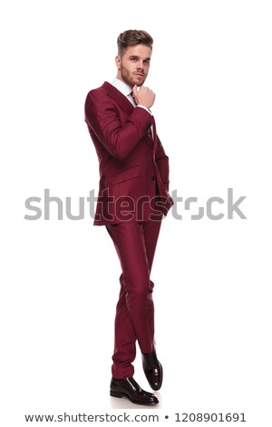 attractive elgant man thinking while standing with legs crossed Stock photo © feedough