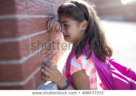 Sześć rok starych uczennica płacz obok Zdjęcia stock © Lopolo