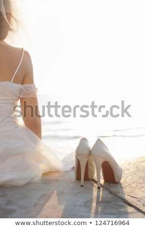 bridal bouquet next to the shoes of a bride Stock photo © ruslanshramko