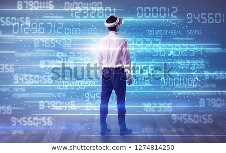 Businessman with variable numbers around Stock photo © ra2studio