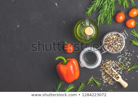 Black, purple, and white rice (Oryza sativa) mix in glass jar on Stock photo © artsvitlyna