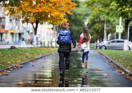 many children running in the rain stock photo © colematt