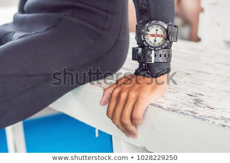 Young diver preparing an underwater compass for diving Stock photo © galitskaya