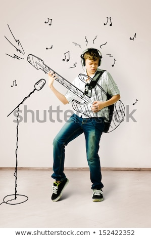cute teen boy with guitar stock photo © boggy