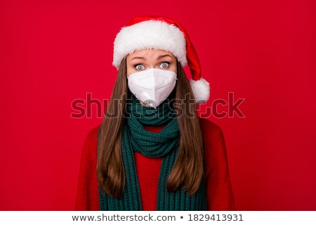 Shocked young girl wearing red santa hat Stock photo © deandrobot