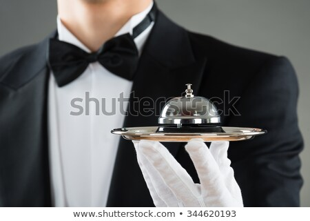 Person Holding Service Bell In Plate Stock photo © AndreyPopov