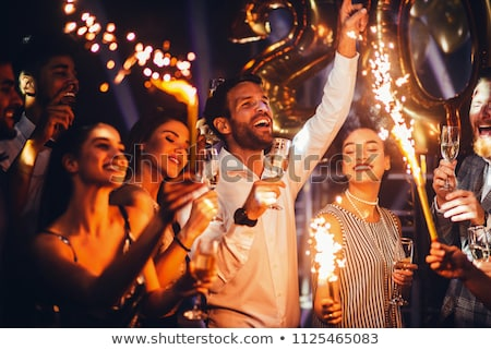 friends with champagne glasses at birthday party stock photo © dolgachov