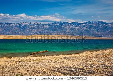 Zadar area stone desert beach scenery and Velebit island view Stock photo © xbrchx
