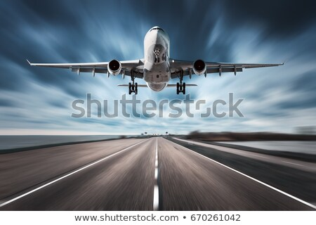 airplane in motion aircraft with motion blur effect stock photo © denbelitsky