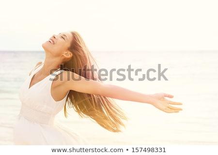портрет · красивой · расслабляющая · пляж · женщину - Сток-фото © monkey_business