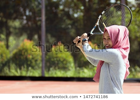 Young tennis player posing with tennis racket stock photo © nyul