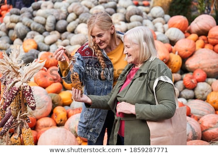 An attractive Mother and Daughter Portrait in Pumpkin Stock photo © Lopolo
