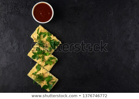 healthy breakfast with crispbread and cream cheese on dark stone stock photo © masay256