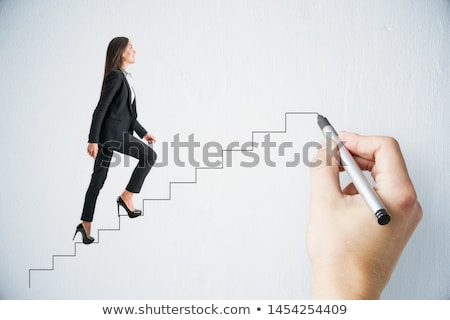 The concept of idea with businesswoman climbing steps stairs Stock photo © Elnur