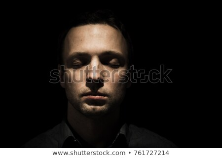 Low key portrait of serious man with eyes closed. Stock photo © lichtmeister