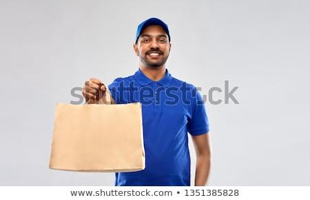 Boldog indiai futár étel papírzacskó szolgáltatás Stock fotó © dolgachov