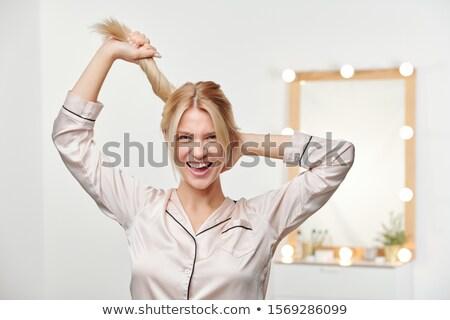 Csinos örömteli lány tart lófarok hosszú Stock fotó © pressmaster