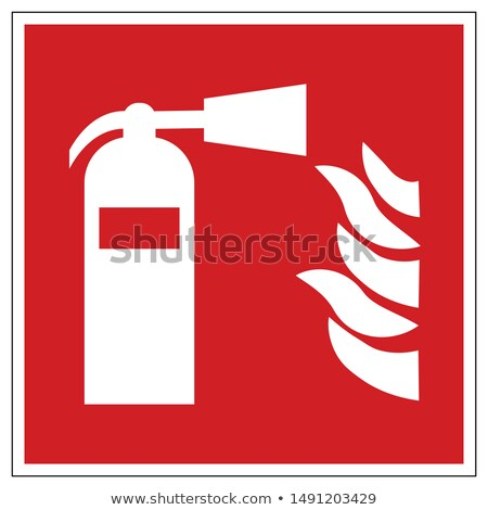 A firefighter is extinguishing the flames Stock photo © studiostoks