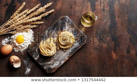 Nyers tészta tagliatelle házi készítésű étel egészség Stock fotó © furmanphoto