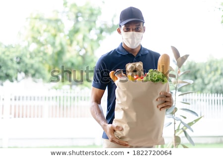 Delivery service under quarantine during the coronavirus epidemic. Stock photo © Illia