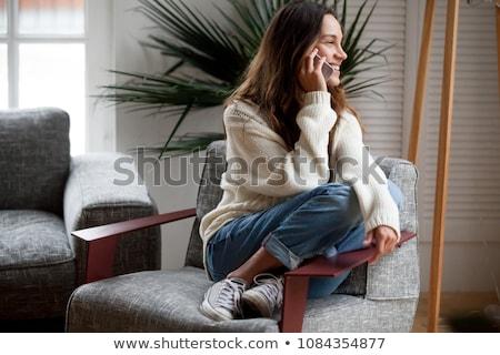 Tinilány beszél telefon mobiltelefon izolált fehér Stock fotó © elenaphoto