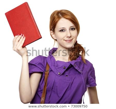 Red-haired girl keep book in hand. Studio shot. stock photo © Massonforstock