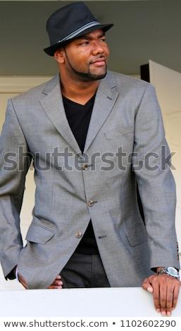 Siyah adam fötr şapka çekici yakışıklı şapka Stok fotoğraf © piedmontphoto