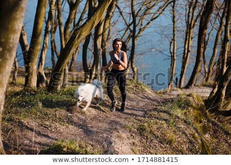 Young woman jogging river park sunny day Stock photo © CandyboxPhoto
